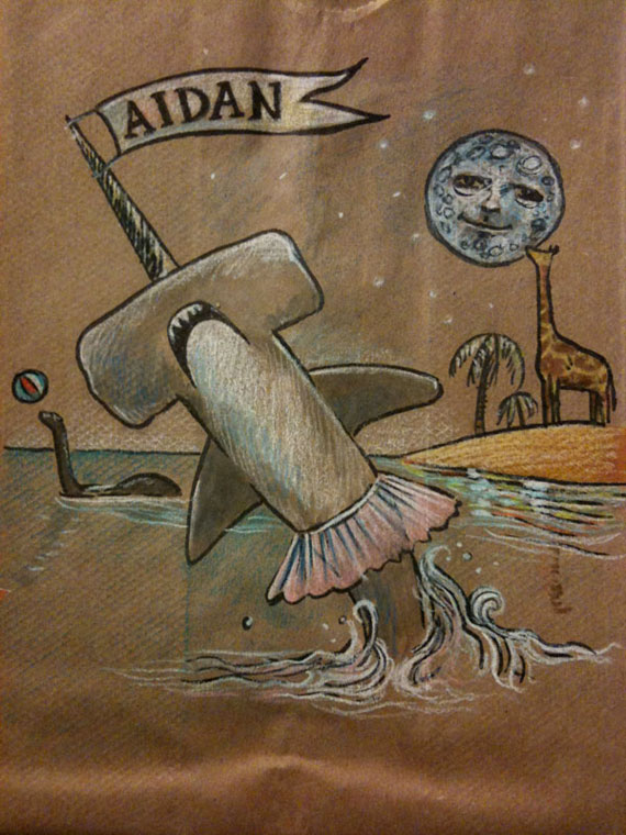 Illustration of lots of stuff, including a hammerhead shark in a tutu, on a lunchbag