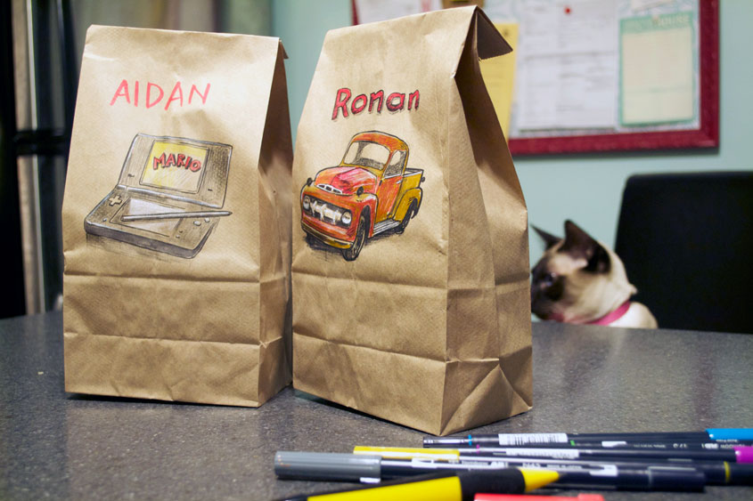 Illustrated lunchbags on counter